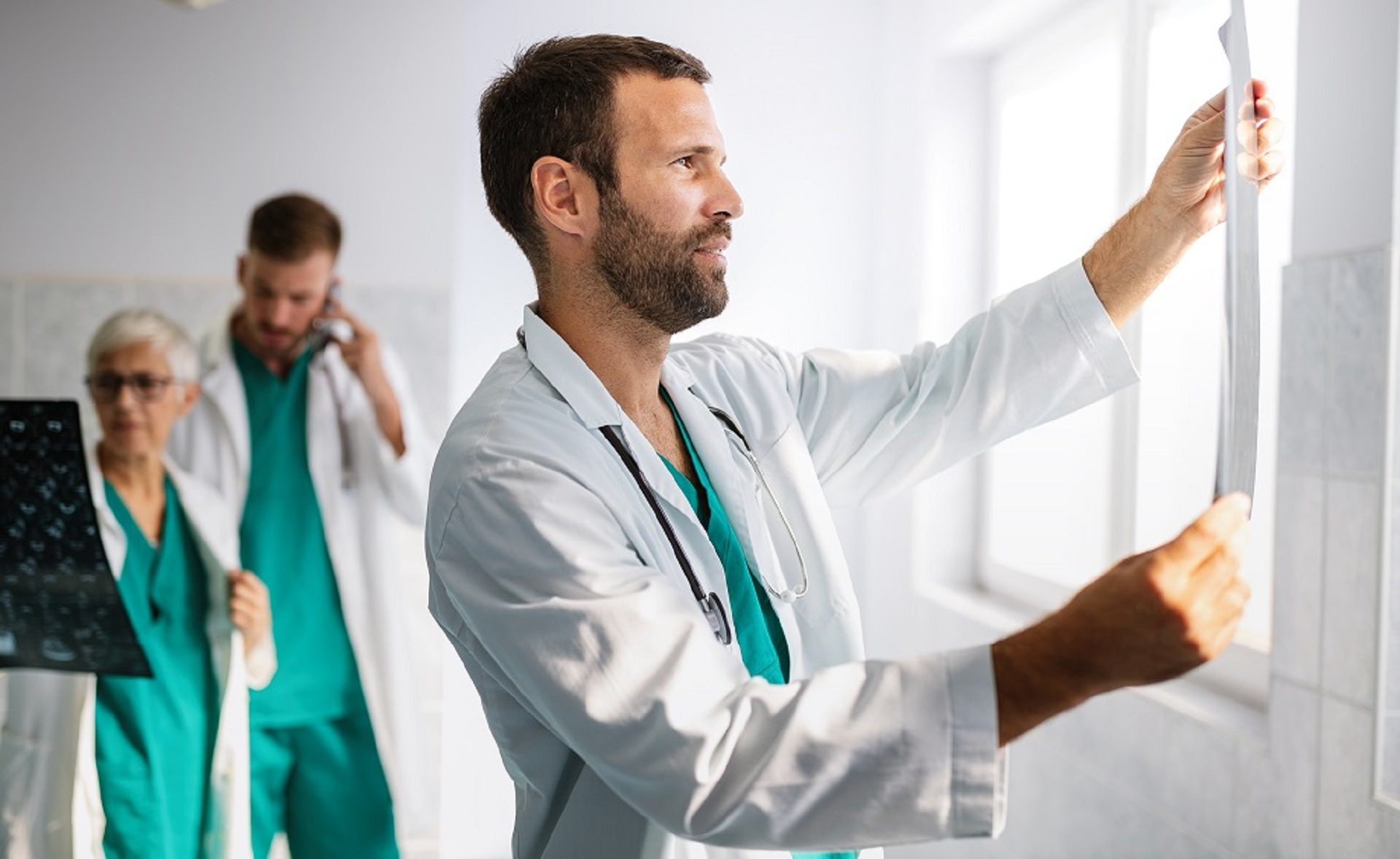 Group of doctors, medical team checking x-rays in a hospital.